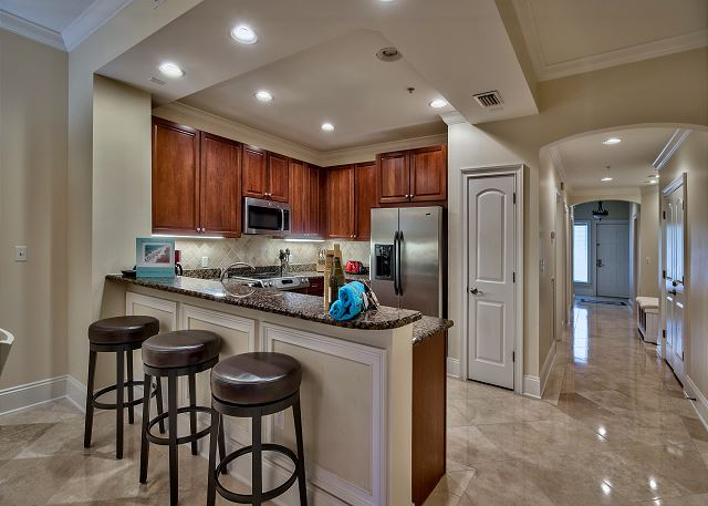 Barstools by granite counter top