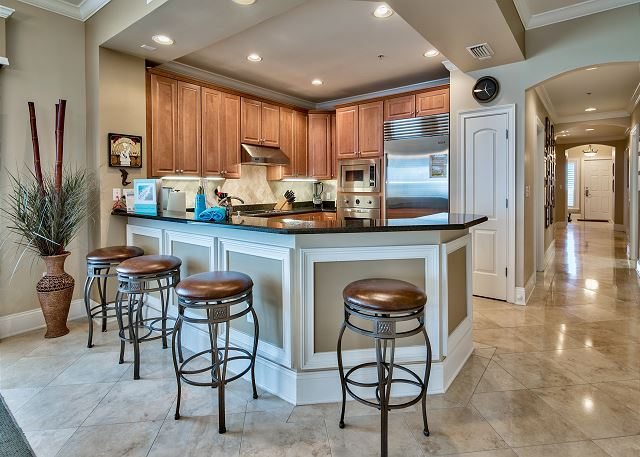 Granite counter tops with comfortable leather barstools