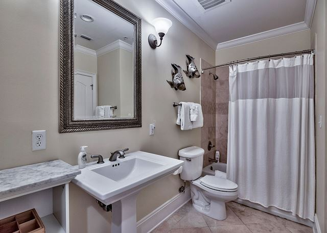Hall Bathroom with tub/shower combination.