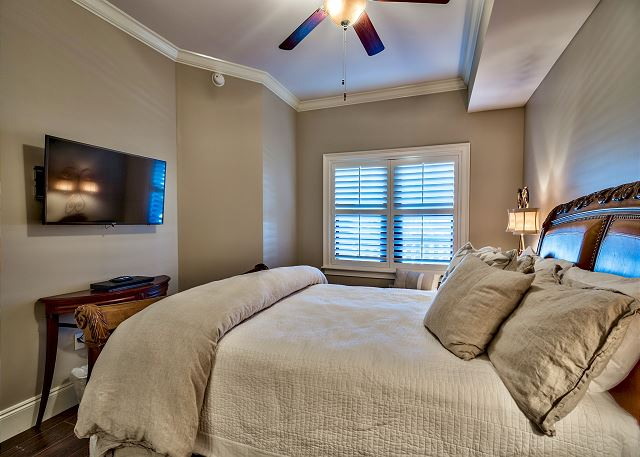 Fourth bedroom with queen bed and large flat screen TV