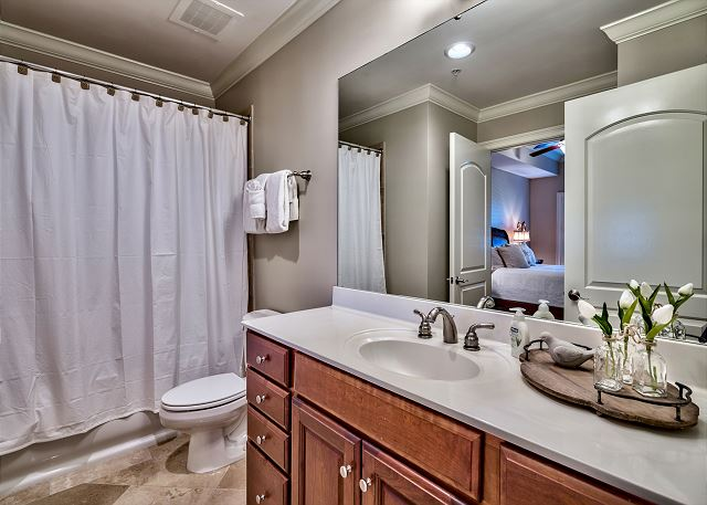 Third bathroom adjoins queen size bedroom.