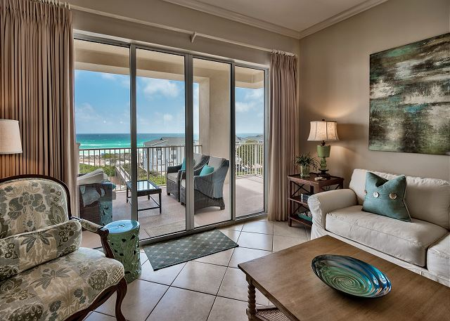 Sliding glass doors to a gulf front view