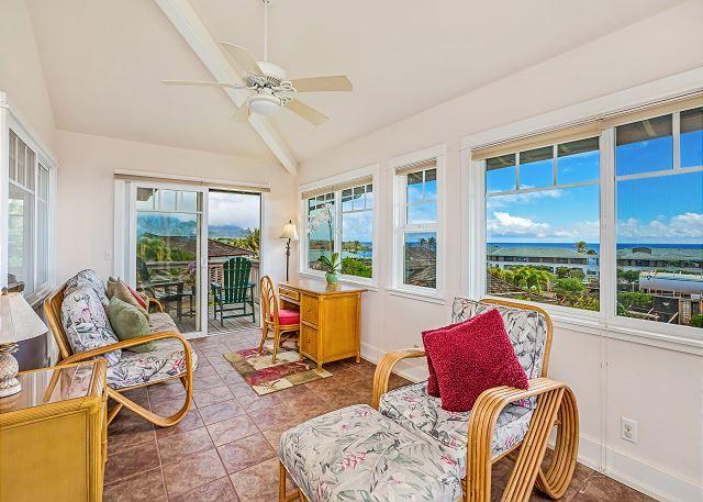 Upper level sun room with ocean views.