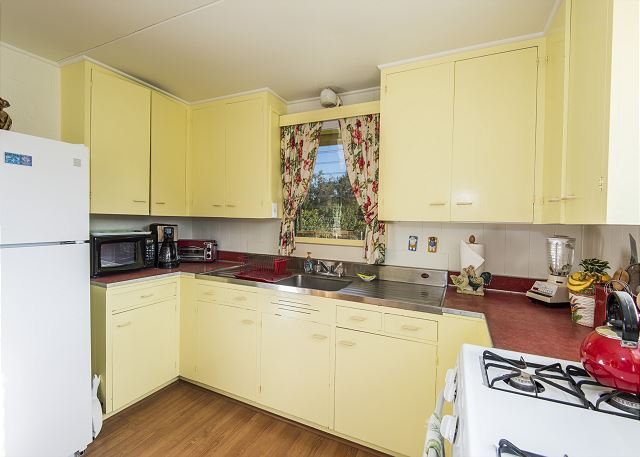 This fully stocked kitchen has a gas stove/oven, full size fridge, toaster oven, coffee maker, blender and more!