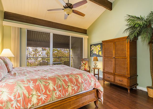 Master Bedroom with King Bed, TV, ceiling fan.