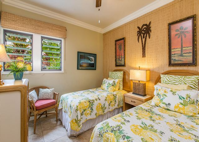 This inviting 2nd bedroom has 2 twin beds.