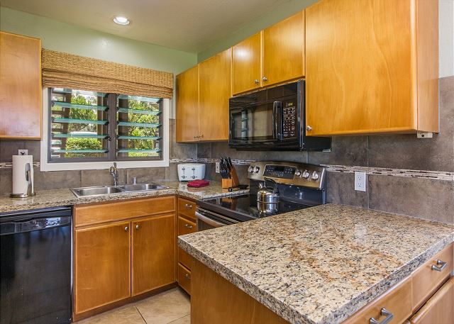 Enjoy cooking meals in your kitchen with beautiful ocean views and new granite countertops.
