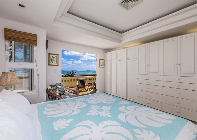 Master bedroom with king bed, tv, and AC
