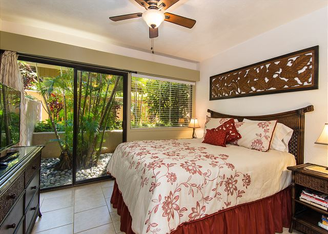 The master bedroom has a queen size bed, flat screen TV and private bath.