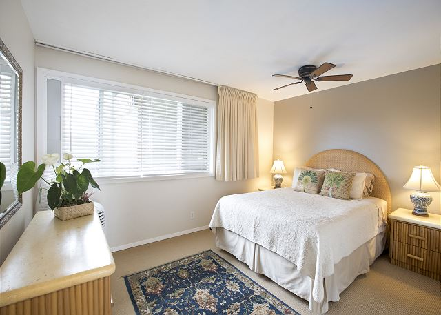 Bedroom with Portable AC and Queen Bed