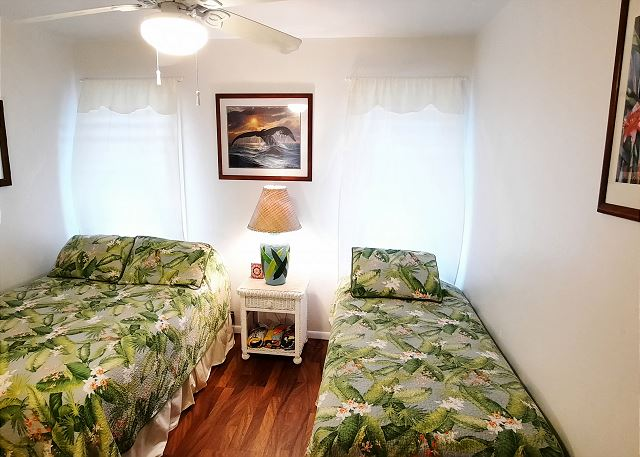 2nd bedroom with full size and twin bed.