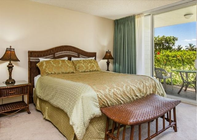 Downstairs bedroom with King bed and outdoor lanai.