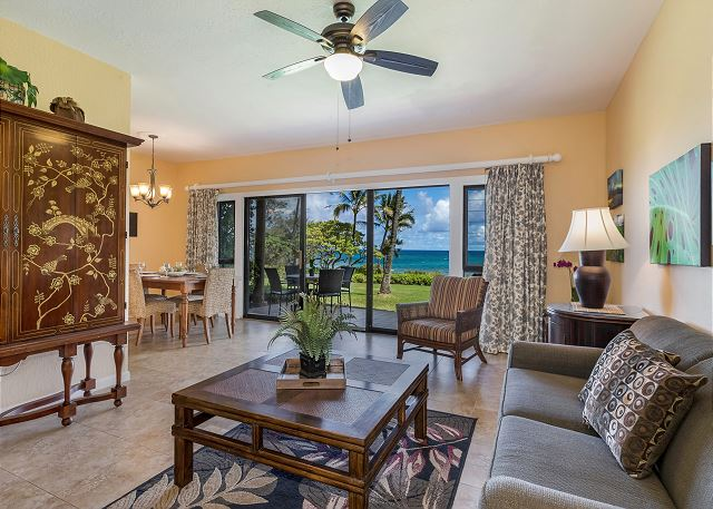 Spacious living area with large flat screen cable TV & ocean vie