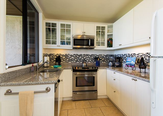 Enjoy cooking meals in your clean and fully stocked kitchen.