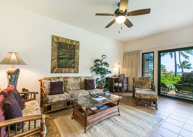 You will feel comfortable at home with beautiful tropical furnishings and cool ocean breezes in this spacious living area.