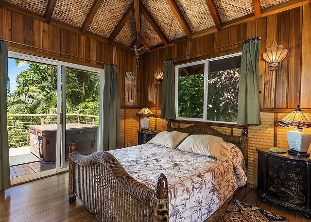 Queen bed with ocean views at Bali Hai Cottage.