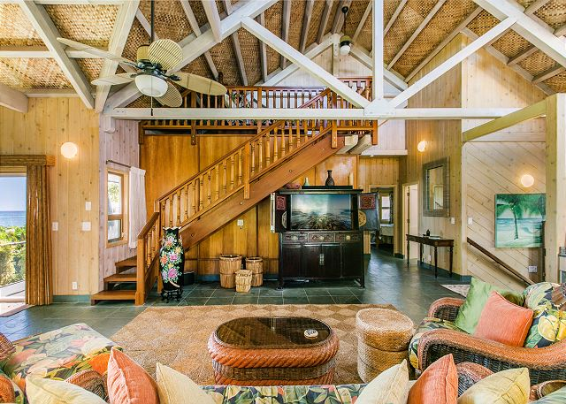 Spacious open beam ceiling Hawaiian Style beachfront home.  Loft area above living room.
