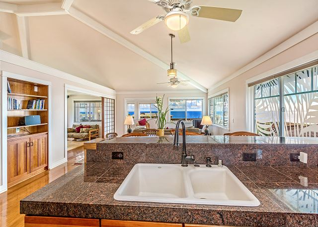 Kitchen with granite counter tops facing the ocean.