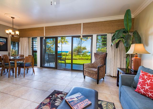 Spacious living room opens up to your private oceanfront lanai.