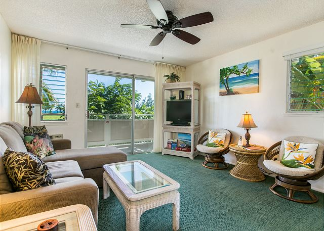 """Living area with TV, Ceiling Fan and """"peek a boo"""" ocean views."""