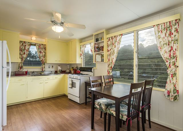Enjoy views of Kalalea Mountain as you cook and dine in the large kitchen area which is fully stocked with all your cooking necessities, gas stove/oven, blender, coffee maker, toaster oven, full size fridge and more!