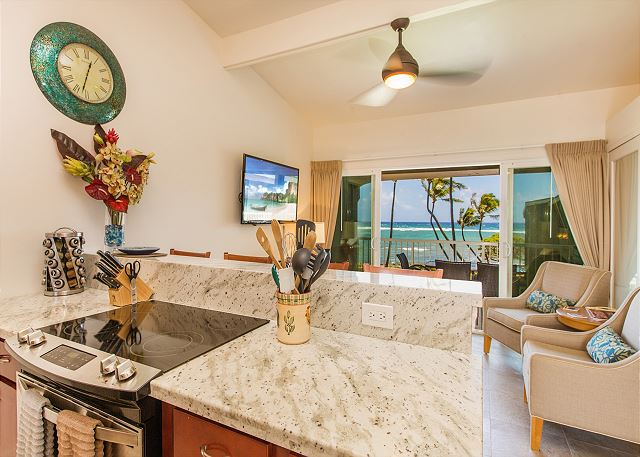 Enjoy cooking in your fully stocked kitchen with granite counter tops and beautiful ocean views.