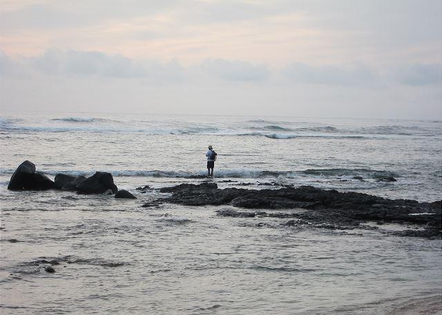 Fisherman checking the ocean at Anahola