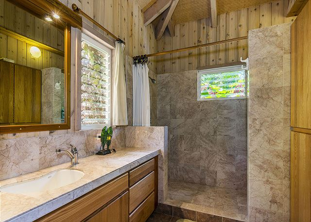 Tiki Suite Bathroom with Double Marble Shower Heads