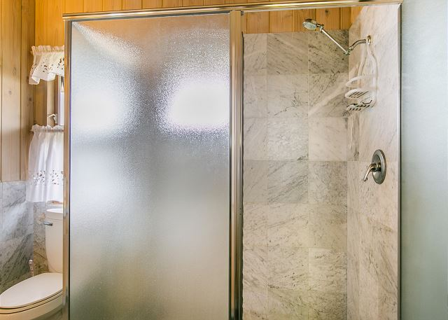 Bungalow Bathroom with Marble Walk-In Shower