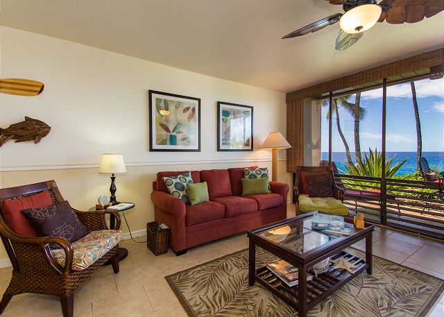 New tile flooring throughout, flat screen TV, pull out sofa sleeper, ceiling fan, and beautiful views of the Poipu sunset from your comfortable living room.