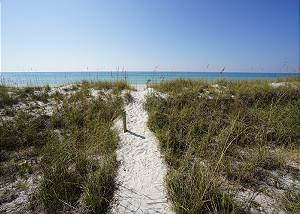 Steps to the water's edge via a private dune path.