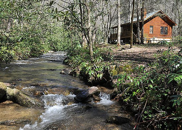 Sit back and rock your cares away at the Creek Front Mountain Cabin Rental in Western North Carolina.