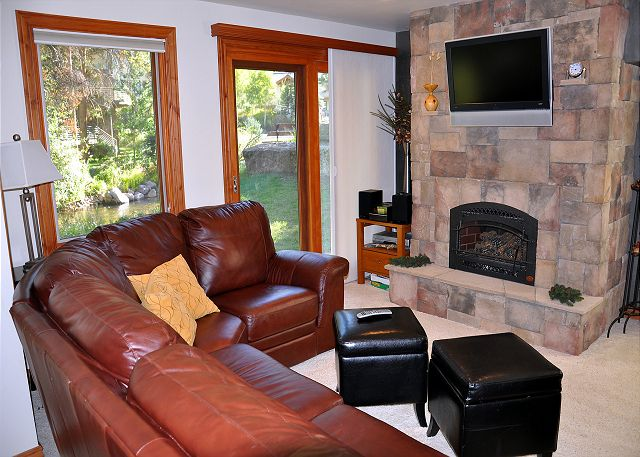 Gas fireplace and a large flat screen TV in the living area.