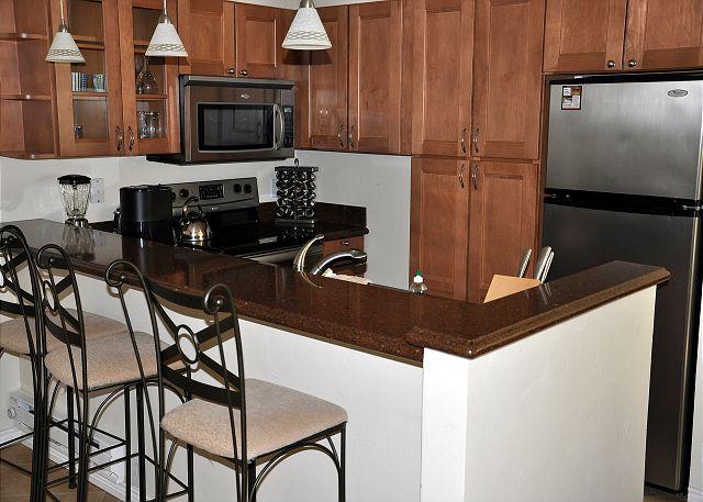 Full granite counter kitchen.