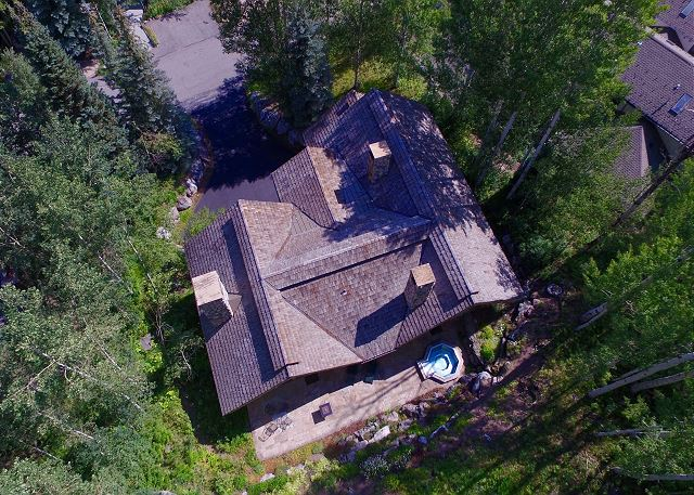 Aerial view of home with hot tub on private deck