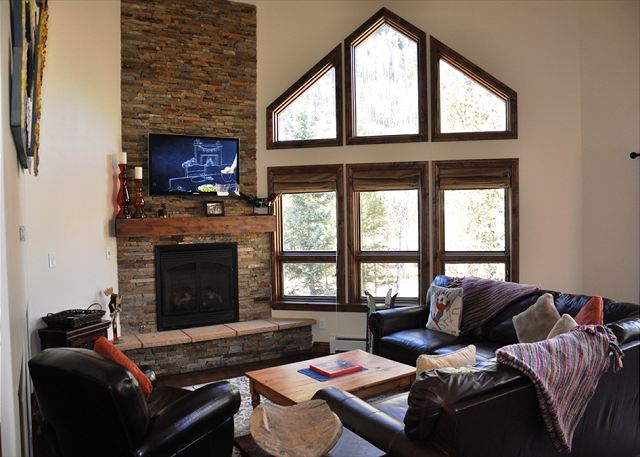 Living Room with flat screen over fireplace