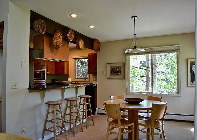 Kitchen, breakfast bar and game table