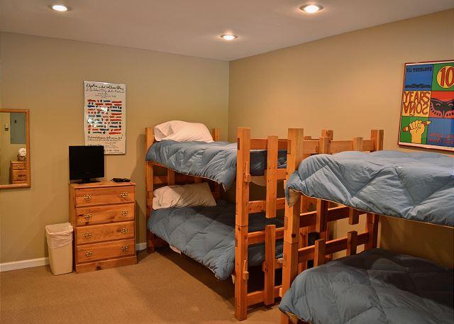 2 sets of bunk beds in bedroom