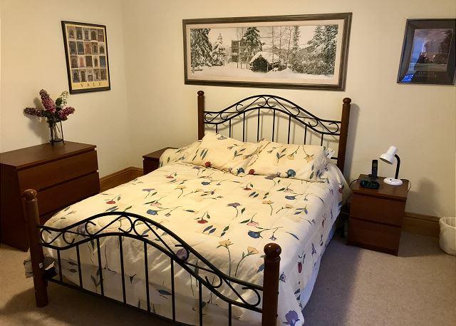 Queen bed in one of the 5 bedrooms