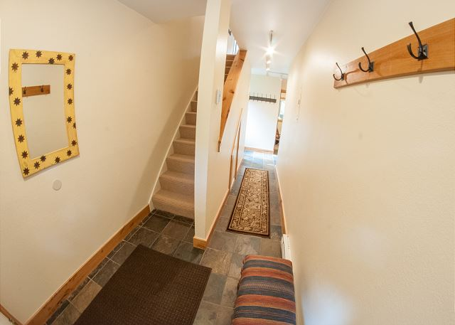 The Entry level has ample space to hang coats and remove boots. The second and third bedrooms are on this level.