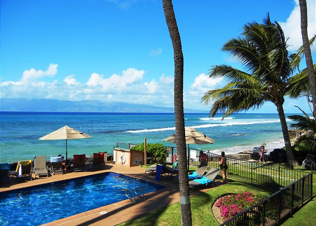 Views from our lanai. Oceanfront pool, BBQ's,tropical gardens and islands