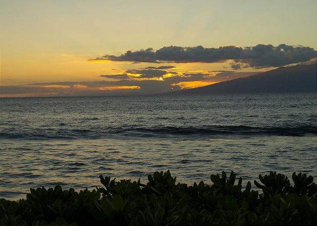 View of sunset over Molokai from the pool
