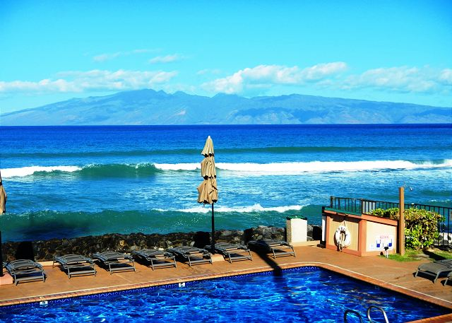 Oceanfront pool and chaise lounges waiting for you