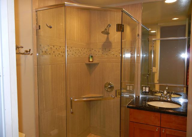 Recently updated with new tile, frameless shower glass, granite counter, full vanity cabinet with Kohler drop in sink and toilet.