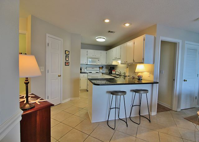 Fully Supplied Kitchen with Breakfast Bar