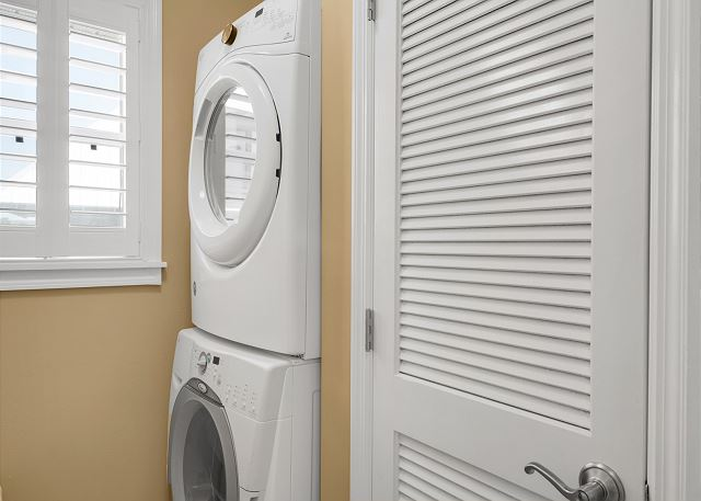 Whirlpool Gold Series full size stack washer and dryer as well as iron and ironing board