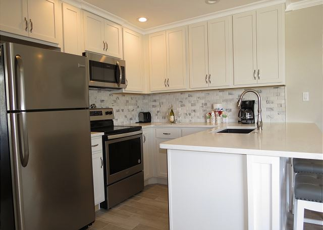 Fully Supplied Kitchen with Quartz Countertops