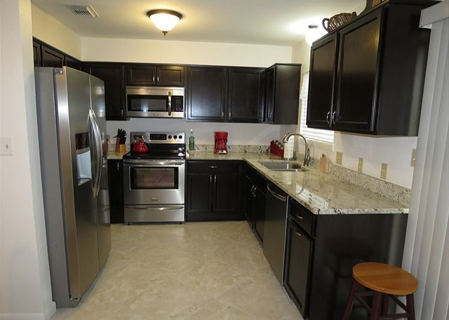 Kitchen fully supplied with dishes,utensils,glassware,&cookware