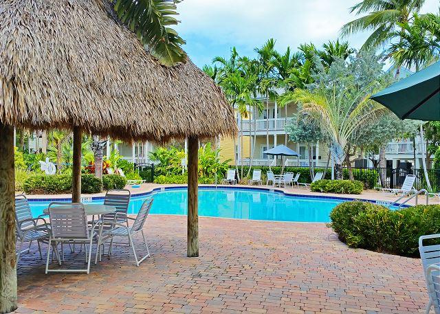large pool lies in the middle of the coral hammock  plex just steps from your doorway  island days rental 3 bed 3 bath sleeps 8 key west pool  rh   historickeywestvacationrentals