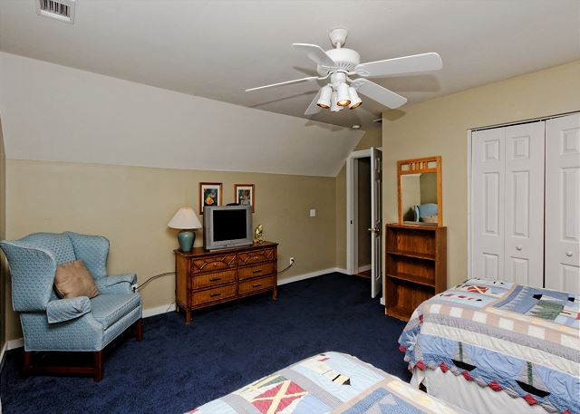 Sleep in comfort under the breeze of the ceiling fan.